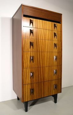 Anonymous; Rosewood and Zebrano Chest of Drawers by Elliotts of Newbury, 1966.