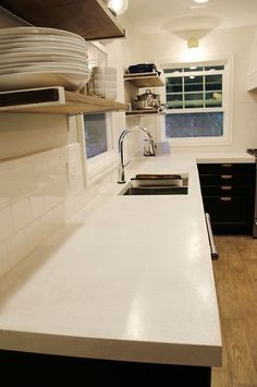 Amazing white concrete countertops and all the detailed how-to's on this blog.