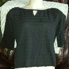 Stretchy plus size knit crop top in black Textured knit fabric is stretchy and slightly see-through but still keeps you warm. Cute bead detail accents notch neckline, like a mini abacus! Three quarter sleeves and loose fitting hem. Cotton poly spandex blend with a slight tendency to pill, but currently in excellent used condition. Xhilaration Tops Crop Tops