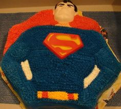 vintage superman cake - strawberry cake with buttercream icing using the old superman wilton cake mold.