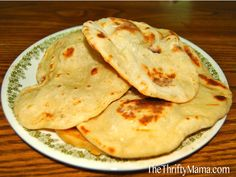 Easy Four-Ingredient Naan Bread (uses only four, plain yogurt, baking powder, and salt) - dough needs to rest for one hour, so take that into account when you make this)