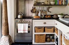 like open shelves with baskets-black counter, white sink, white cabinets below, just want oven higher, farmhouse sink, and wooden shelves