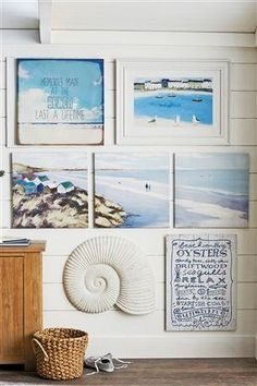 Great collection of coastal art to create this fun little gallery wall
