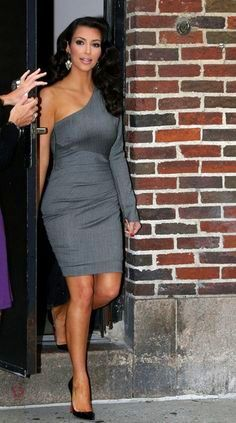 Perfect for her spape. Love the length and that it's still a hot dress.