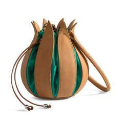 MEDIUM 25 CM A bag in the shape of a Tulip. Opens like a flower with inside a little pocket.Very clear and an eye-catcher first class. This version is made of special leather with canvas. Leather tulip bag.