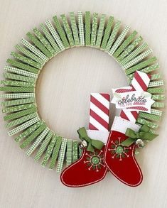 Project: Clothes Pin Wreath This oh so fun wreath was made with 4 half sheets of patterned scrapbooking paper and 65 clothes pins. Erin Lincoln used a die cut that fits a cloths pin to make the work go faster but you could us… Wreath Crafts, Diy Wreath, Christmas Projects, Holiday Crafts, Christmas Crafts, Christmas Decorations, Christmas Ornaments, Wreath Ideas, Tulle Wreath