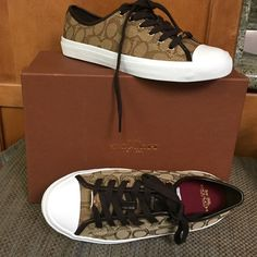 Coach Sneakers NWT signature print upper, vulcanized rubber outsold, lace up design, padded cushion insole.  Great reviews! Coach Shoes Sneakers