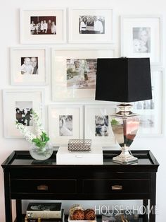 White frames create a formal, cohesive look while a black console adds contrast.