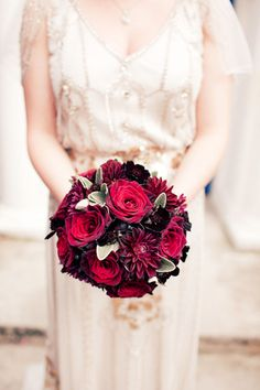 Black dahlias and berries made a lovely bouquet in this vintage real wedding!  #dahliabouquet #rosebouquet