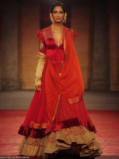 Krishna Somani walks the ramp for designer Anju Modi on Day 1 of Delhi Couture Week, held in New Delhi, on July 31, 2013.