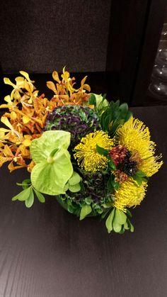 Gorgeous fresh floral arrangement for #fall: Orchids, Anthurium, Pinchushion Protea, Hydrangea, and Hydpericum Berries!