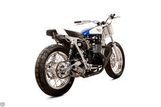Built as a homage to the legendary Triumph racer's 1971 Triumph Team bike, this 2015 Bonnie is emblazoned with the famous Blue and White Triumph team colors. Sporting a custom fuel tank and tail section, chopped silver-painted frame, fabricated two-into-two exhaust, Beringer brakes and a long list of Mule and British Customs bits, the stripped-down Tracker definitely looks the business.