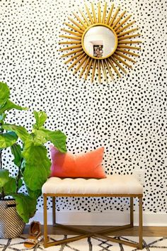 spotted wallpaper, sunburst, orange pillow, plant Style At Home: Gaby Burger | theglitterguide.com