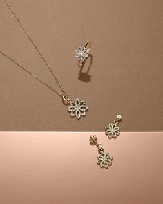 The Lace Botanique series in 14k gold is inspired by the intricacy of antique lace patterns. Combining a stylised floral outline with sparkling accents, the pieces pay tribute to the timeless beauty of lace. #PANDORA #PANDORAnecklace #PANDORAearrings #PANDORAring