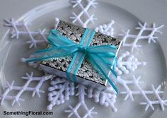 Favors for a Tiffany blue and silver, ice skating themed, winter bridal shower.