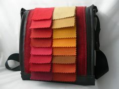 Bag made out of bicycle inner tubes and as decoration ex fabric samples!Lined with red felt! Seatbelt strap! All recycled!