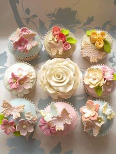 Petite flowers in floral tubes could be inserted into frothy-iced cupcakes for an effect similar to this! (see rose in center)