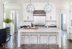 With turkey day only days away check out these gorgeous, Thanksgiving-ready kitchens for plenty of inspiration for the heart of the home. Kitchen Showroom, Kitchen Store, Dutch Colonial Homes, Hamptons Kitchen, Antique Dining Chairs, Low Cabinet, Atlanta Homes, Custom Kitchens, Kitchen Pictures