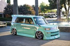 I think the body kit is absolutely ugly but I would paint my little toaster that exact color in a heartbeat!  =)