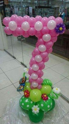 Pink Number 7 balloon sculpture with spring themed base. Sweet!