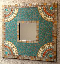 This is a 24 x 24 one-of-a-kind mosaic mirror with a 7 square inset.This mirror just shimmers under the lights. The honey gold and pearlescent ivory of the glass tiles around the border give off an iridescent glow and the color changes depending on the light. It really makes this a stunning piece. Difficult to capture in a photo.    The fans at each corner have tiles I cut from beautiful golden yellow colored plates with a hint of aqua and orange against the gold leaves. There are also flat…