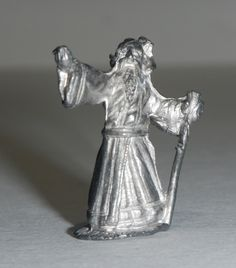 """For Sale : 1x unpainted Miniature Metal Figure of a Magician (Magic User) with his cane, released by Ral Partha for Dungeons and Dragons in the 1970s. In excellent, very slightly used condition. About 1.5"""" tall. Buy in confidence from a Dungeon..."""