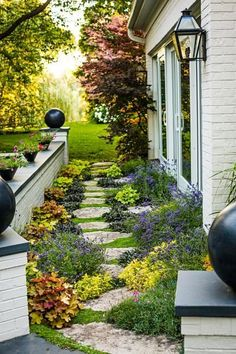 Stepping-stones surrounded with sprawling groundcovers and fragrant herbs make a spectacular path suitable for a narrow side yard or garden. More garden design ideas: http://www.midwestliving.com/garden/featured-gardens/garden-tour-pattern-play?page=3