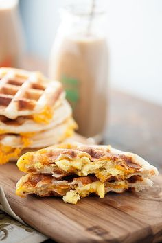 """Stuffed Biscuit Waffles: In a genius culinary experiment, this blogger stuffed scrambled eggs and shredded cheese into biscuit dough—then put it all in a waffle iron. The result was these """"perfect little handheld breakfast sandwiches."""" Add bacon bites or diced ham for extra flavor."""