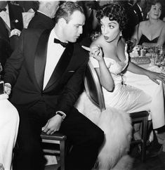 """The ORIGINAL: Marlon Brando and Mexican actress Katy Jurado (born María Cristina Estela Marcela Jurado García; January 16, 1924 – July 5, 2002) at an Awards ceremony, ca.1955. Marlon Brando was smitten with Jurado after seeing her in """"High Noon"""" (1952). They had an extended affair that lasted many years and peaked at the time they worked together on """"One-Eyed Jacks"""" (1960), a film directed by Brando."""
