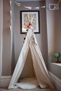Paper airplane garland and teepee by NiftyNeat on Etsy