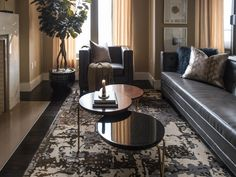 A tufted area rug in an abstract print brings life to the space. The blend of muted neutrals adds an interesting focal point without overwhelming the space.
