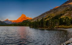 Download wallpapers Swiftcurrent Lake, sunset, mountain lake, mountains, USA, Montana