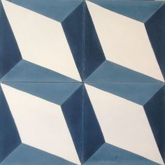 The Nadia Encaustic Tiles is one of our most popular cement tiles. This Geometric design can be placed either in a 'star' pattern or in a 'cubic' or 3D pattern. Our stock version comes in blue on White, but we have made a series of bespoke varieties including Black and blue, grey and Black and green and grey (pictured). If you would like to see this design in bespoke colours please get in touch to discuss your requirements.