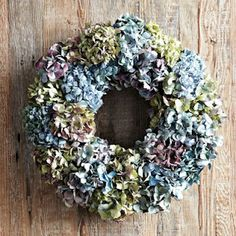DIY Hydrangea Wreath - Williams Sonoma  Grapevine wreath   7 green hydrangea stems   2 white-ish hydrangea stems   hot glue & gun   wire cutters