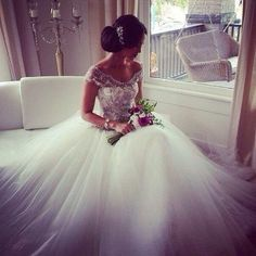 Stunning. Love the off the shoulders look and the tool at the bottom of the dress floats like a cloud.