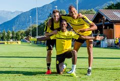 Raphael Guerreiro Ousmane Dembele PierreEmerick Aubameyang of Borussia Dortmund during a training session on the training ground of Bad Ragaz during...