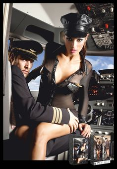Ready for delightful flights. Black dress with sparkling and transparent long sleeves. With a black shiny, opaque look, the two breast pockets, collar and wrist cuffs convince each passenger of a comfortable seated posture. With gold-coloured Baci Airlines pin and shiny black hat.