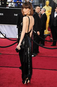 "Rose Byrne in Vivienne Westwood.  The actress accessorized the backless design with colorful Chanel earrings, Jimmy Choo heels.  2012 Oscars          MyPoints.setMPCookieName(""MP_TRACK"");    MyPoints.setMPCookieExpHours(""48"");    MyPoints.setVIDParamName(""vid"");      MyPoints.landing();"