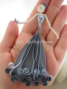 A beautiful doll by Paper Quilling method.