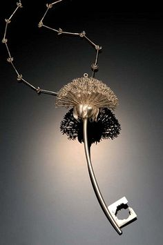 "Anika Smulovitz, Artist, Dandelion Key, 2002, sterling silver; 5"" x 2 1/8"" x 2 1/8"", chain 33"", photographed by Jim Wildeman"