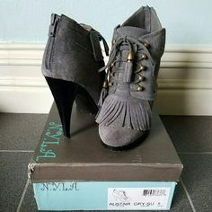 N.Y.L.A. Gray Fringe Booties Adorable gray suede fringe lace up booties with zip up enclosure in the back. Perfect for dresses or skinny jeans. Tried on but never worn. N.Y.L.A. Shoes Ankle Boots & Booties