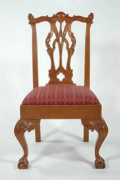 Chippendale side chair, 1770. Thomas Chippendale published three catalogs of furniture and decorative designs throughout his carreer.  This chair exhibits all of the Chippendale earmarks: carved top rails, pierced back splat, upholstered seat, carved cabriole legs, and ball and claw feet.