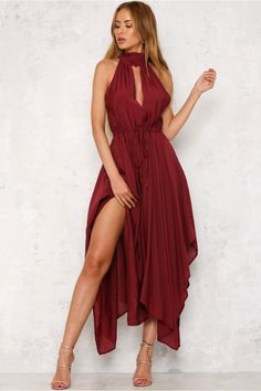 The Stunner Maxi Dress is sleeveless, with a high neck and a self-tie bow at the back. We love the long flowy skirt! Style with lace up heels and dangling earrings!   Maxi dress. Not lined. Cold hand wash only. Model is standard XS and is wearing XS. True to size. Non-stretchy fabric. Polyester.