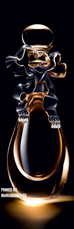 Christian Dior J'Adore Diamond encrusted bottle, Baccarat crystal bottle has an embellished bow set with 10 pear-cut diamonds  and 30 round cut diamonds!