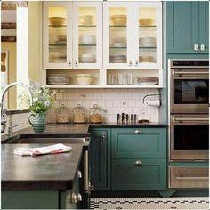 Black white floor, green lowers, black countertops, white back splash, white uppers