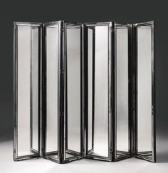 SERGE ROCHE  SIX-PANEL SCREEN circa 1940  mirrored glass and lacquered wood  221.3 x 49.8 x 3.2 cm  Estimate: 100,000 - 150,000 USD