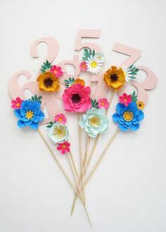 Lovely handmade floral birthday cake topper. These gorgeous numbers are customisable so you can match them to your colour theme, just choose from the 40 colours available! They are handmade in east london, and all the flowers are individually curled and folded. The flower arrangements are different on every number so yours may differ slightly from the ones in pictures. Leave the numbers you would like in the comments box at checkout, they cost £6.50 per digit, so if the age you need is…