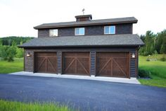 Even the extras are log, in this 3 car garage with great barn style doors and even a weather vane! 3 Car Garage, Garage Shop, Garage Plans, Garage Doors, Ultimate Garage, Barn Style Doors, Outdoor Living, Outdoor Decor, Garages