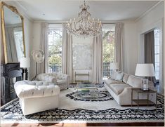 jon vaccari design - white and black design and crystal chandelier - Living Room