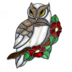 Owl, owl on flower branch, stained glass owl suncatcher, stain glass owl ornament on Etsy #StainedGlassOwl